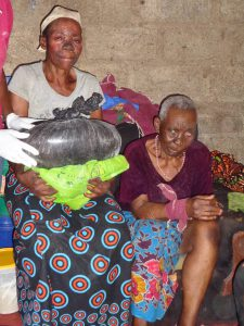 Old, partially; paralysed by stroke and blind old lady (right) and looked after by well wishers benefitted from the donations.