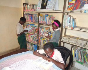 TOSF learners reading in the library.